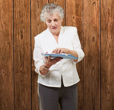 Senior woman using ipad, indoor photo