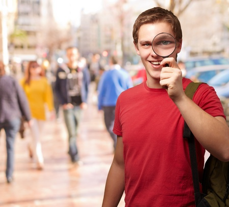 Portrait Of A Student Looking Through Magnifying Glass, Outdoor photo
