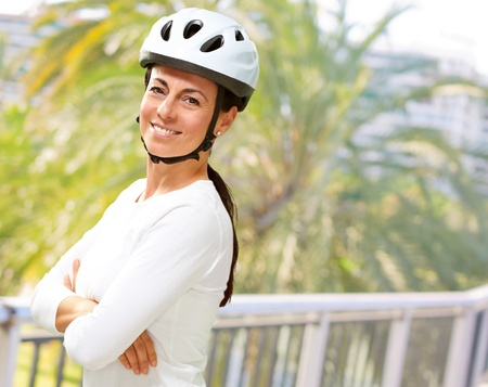 Woman Wearing Helmet With Hands Folded, Outdoor photo