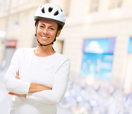 Woman Wearing Helmet With Hands Folded, Outdoor Stock Photo - 16289407