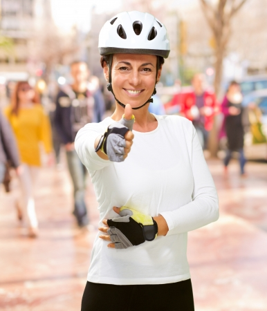 Woman Wearing Helmet Showing Thumb Up, Outdoor photo
