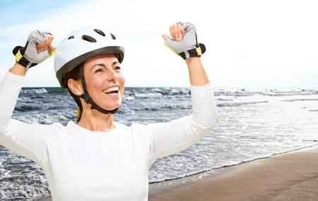 Woman Wearing Helmet Cheering, Outdoor photo