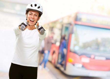 Woman Wearing Helmet Showing Both Thumbs Up, Outdoor photo