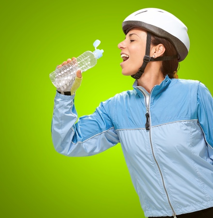 Women Drinking Water On Green Background Stock Photo - 16290307