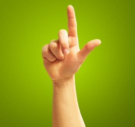 Human Hand With Point Finger On Green Background photo
