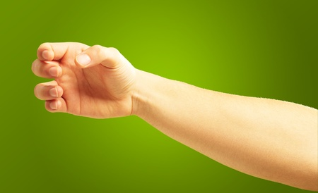 hand grip: Human Hand Holding On Green Background Stock Photo