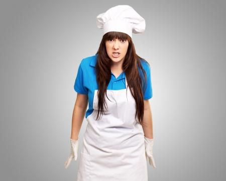 Clench Of Woman Cook On Gray Background photo