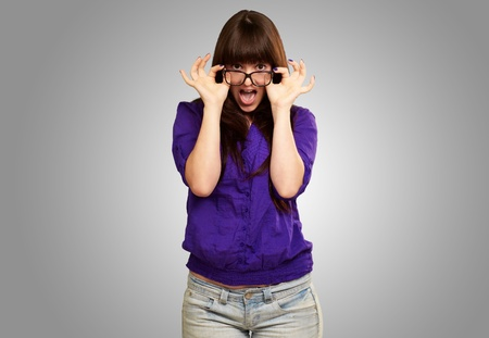 funny glasses: Portrait Of A Young Lady On Gray Background Stock Photo