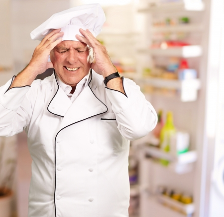 painfully: Portrait Of Chef With Painfully Head, Indoor