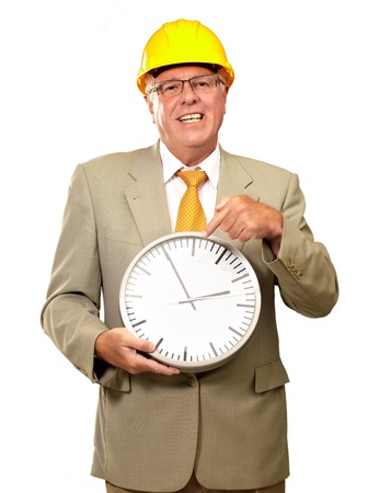 punctual: Portrait Of A Senior Man Holding A Wall Watch On White Background Stock Photo