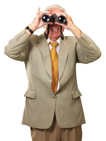 Senior Man Looking Through Binoculars On White Background photo