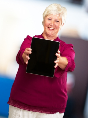 Portrait Of A Senior Woman Holding A Laptop, Background photo