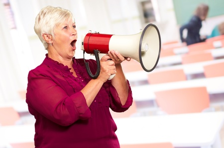 Portrait Of A Senior Woman With Megaphone, Indoor photo