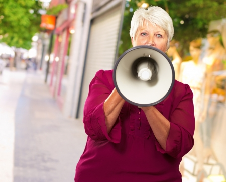Portrait Of A Senior Woman With Megaphone, Outdoor photo
