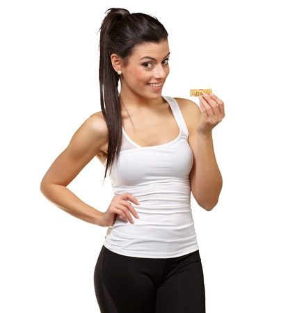 Portrait Of A Woman showing Granola Bar On White Background photo