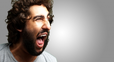 Portrait Of A Man Shouting On Grey Background photo