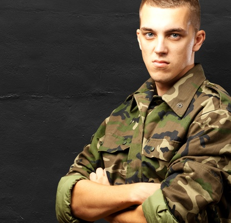 military man: Portrait Of Angry Soldier against a grunge background