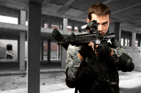 Portrait Of A Soldier Holding Gun, outdoor Stock Photo - 16690560