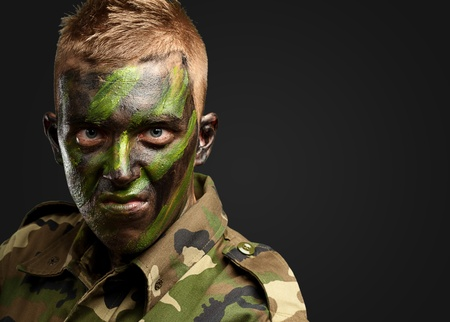 Close Up Of Angry Soldier against a black background Stock Photo - 16690479