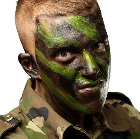 portrait of a soldier with camouflage painting against a white background Stock Photo - 16690568