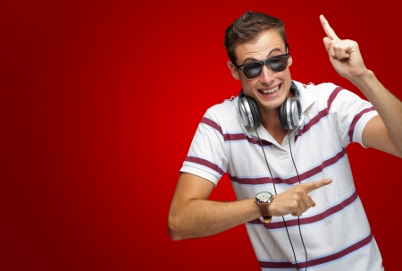 Portrait Of A Man Wearing Headphone Dancing On Red Background Stock Photo - 16690572
