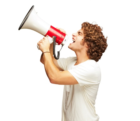 Portrait Of Young Man Shouting With A Megaphone Isolated On White Background photo
