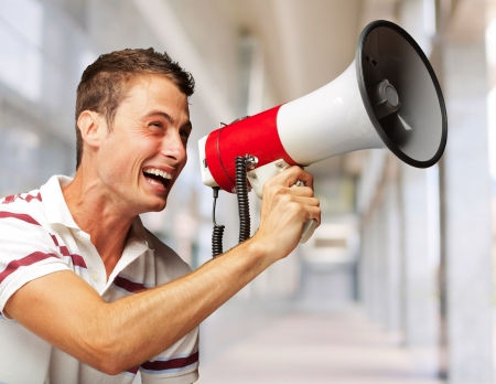 Portrait Of A Young Man Shouting With Megaphone, Indoor photo