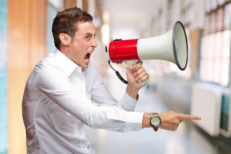 Portrait Of Young Man Shouting On Megaphone, Indoor Stock Photo - 16690632