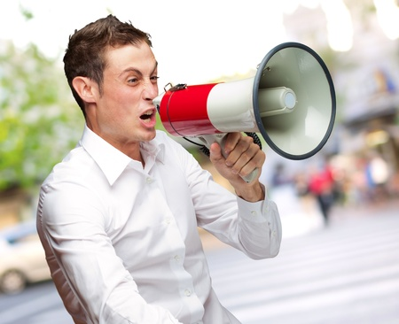 Portrait Of Young Man Shouting On Megaphone, Outdoor Stock Photo - 16690714