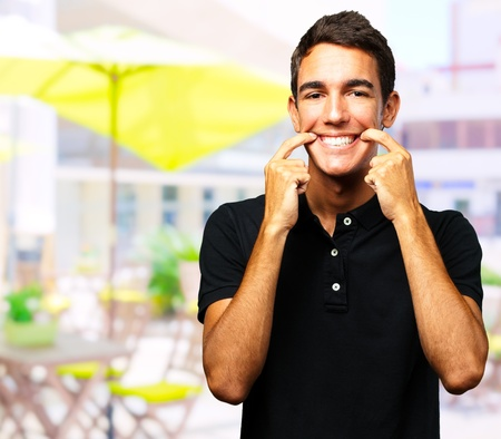 Portrait Of Happy A Boy standing in front of a restaurant Stock Photo - 16672399