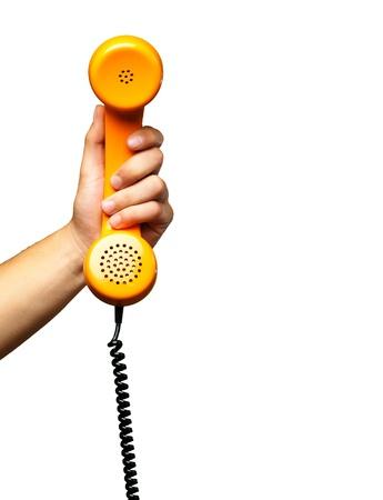 telefono antico: Stretta Di Mano che tiene telefono su uno sfondo bianco