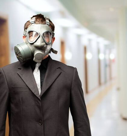 Businessman With Gas Mask, indoor Stock Photo - 16672387