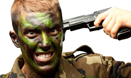 anti stress: Soldier Putting Gunshot On Head On White Background Stock Photo
