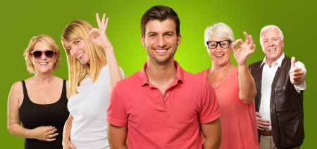 Group Of People Showing Hand Sign On Green Background photo