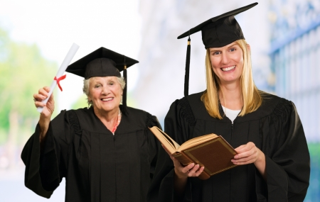 Two Graduate Woman, Outdoors photo