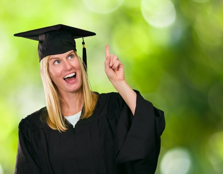 Graduate Woman Holding Digital Tablet against a nature background Stock Photo - 16672338