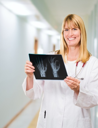 Portrait Of Happy Doctor Holding X-ray in a passageway Stock Photo - 16672468