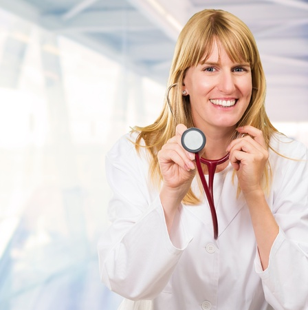 Happy Doctor Holding Stethoscope, indoor Stock Photo - 16671762