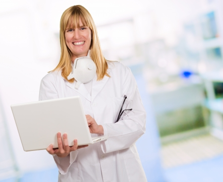 Female Doctor Using Laptop in a room photo