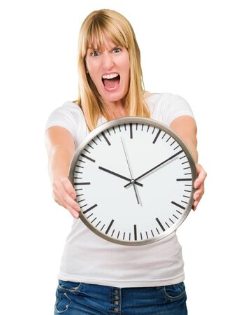 angry blonde: Portrait Of A Angry Woman Holding Clock On White Background