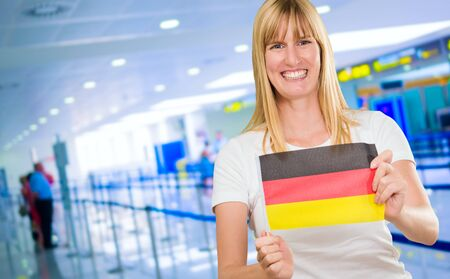 woman holding a german flag in the airport Stock Photo - 16672490