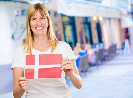 woman holding a denmark flag, outdoor Stock Photo - 16672502
