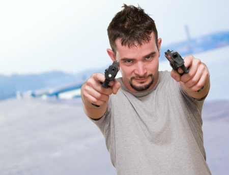 Portrait Of A Man Holding Gun at a port Stock Photo - 16672400