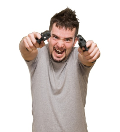 angry man aiming with guns against a white background Stock Photo - 16672360