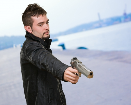 Portrait Of A Man Holding Gun at a port Stock Photo - 16672407