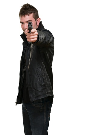 man with leather jacket pointing with gun against a white background Stock Photo - 16672371