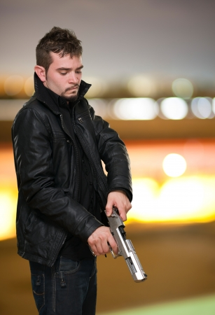 Portrait Of A Man Loading Gun, outdoor photo