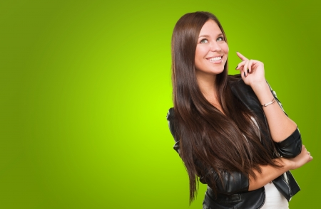 Portrait Of A Happy Woman against a green background