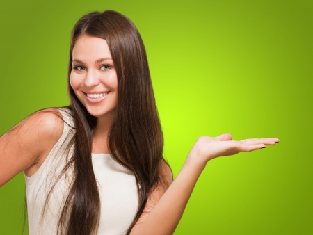 Happy Woman doing a gesture against a green background