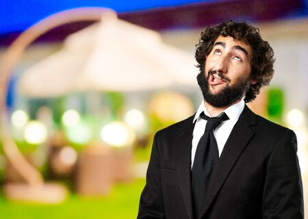 Portrait Of An Unhappy Man at a restaurant photo